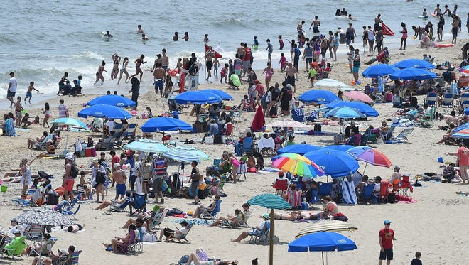 Last year, cool weather kept visitors out of the water in Rehoboth Beach. But there was crowd on the beach and boardwalk.