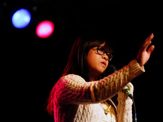 Register reporter Linh Ta shares her story Thursday, April 28, 2016, during the Des Moines Storytellers Project at Wooly's.