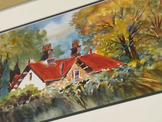 A watercolor by artist Mick Benson hangs in his Sartell
