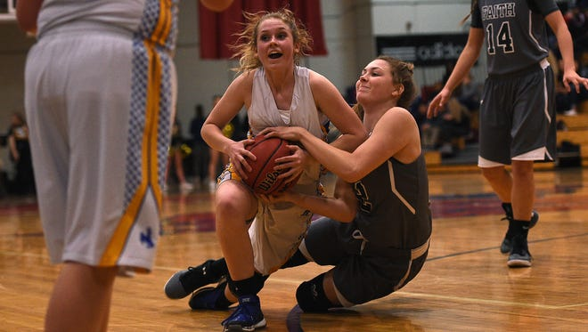 Lowry's Brooklyn Backus (12) and Faith Lutheran's Maddy Larson (12) battle for a loose ball during their game at Reno High School on Friday.