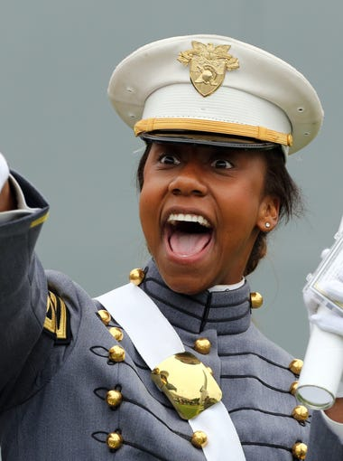 A member of the United States Military Academy graduating class of 2014 points to family after receiving her diploma during commencement exercises at West Point May 28, 2014. President Barack Obama spoke at the graduation, laying out his vision for American foreign policy after the nation fought two wars since the attacks of Sept. 11, 2001.