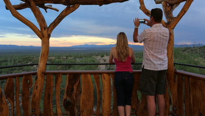 Visitors catch a desert sunset during the Cool Summer Nights events at the Arizona-Sonora Desert Museum in Tucson.