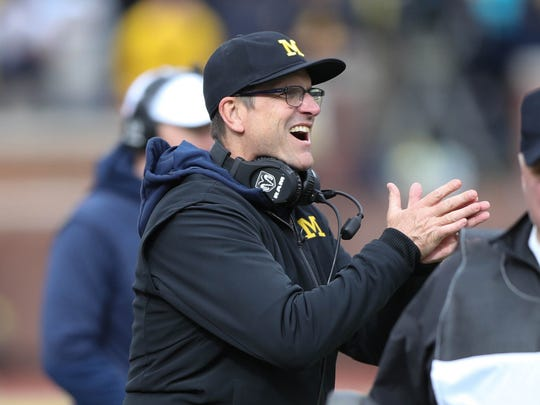 Jim Harbaugh claps in the fourth quarter of Michigan's 35-14 win over Rutgers on Saturday, Oct. 28, 2017 at Michigan Stadium.