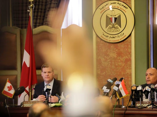 Canadian Foreign Minister John Baird, left, and his