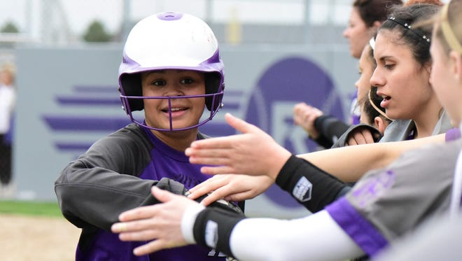 Braelyn Horn of Fremont Ross wears her trademark smile as she's congratulated by teammates.