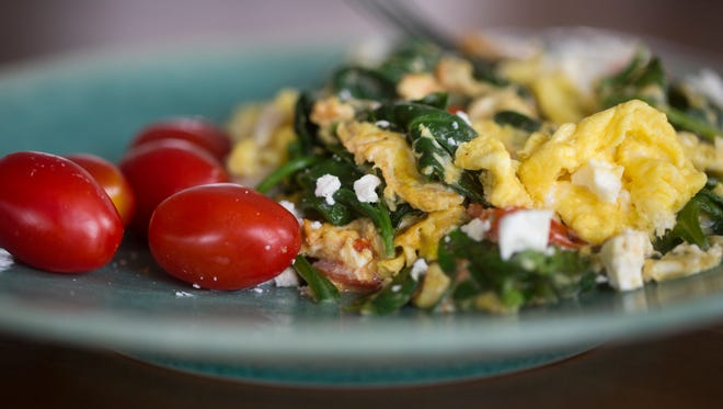 Polly Campbell creates a healthy breakfast with eggs, spinach, tomatoes and feta.