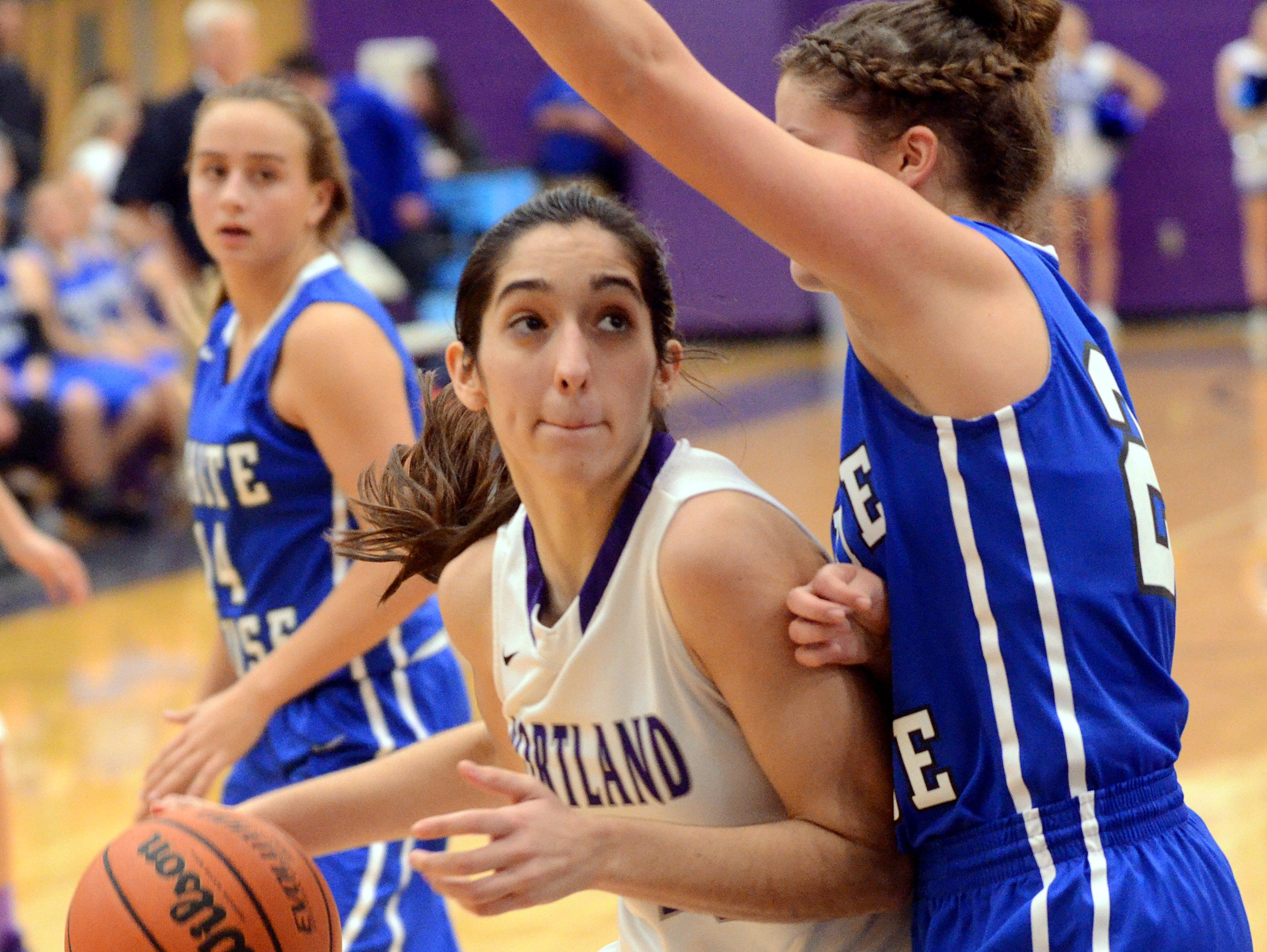 Portland High junior forward Mackenzie Trouten maneuvers inside as White House junior Bailey Hutchison defends and as Lady Devil sophomore McKenzie Vaughn looks on. Trouten scored a career-high 22 points in the Lady Panthers' 67-40 victory on Tuesday evening.