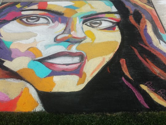 A portrait done by Paige Bootz for 2015 Chalkfest in downtown Wausau.
