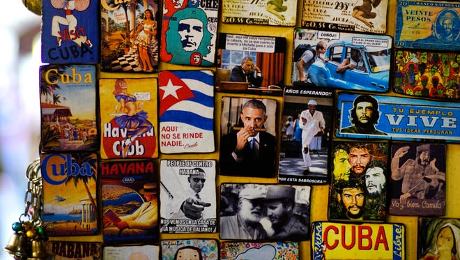 Refrigerator magnets are displayed for sale in a tourist shop, several showing images of U.S. President Obama, at a market in Havana, Cuba, Monday. President Obama will travel to Cuba on March 20. (AP Photo/Ramon Espinosa) ORG XMIT: XRE103