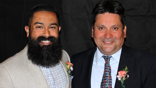 David Nuñez, right, social studies teacher and track and field coach at Oñate High School, stands alongside Noel Martinez, left, lead welder at the LCPS Physical Plant Department, after he was named the 2019 LCPS Teacher of the Year and Martinez was named the 2019 LCPS Educational Support Personnel of the Year.