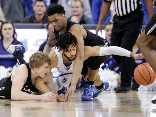 Xavier's J.P. Macura, left, Trevon Bluiett, top right,
