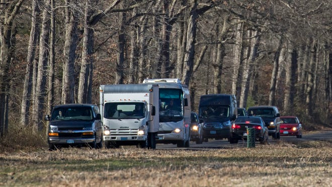A convoy of vehicles with diplomatic plates drives away from a Russian compound near Centerville, Md., on Dec. 30. The day before, President Obama announced the expulsion of 35 Russian diplomats and the closing of two compounds used by the Russian officials in retaliation for alleged computer hacking attacks during the election.