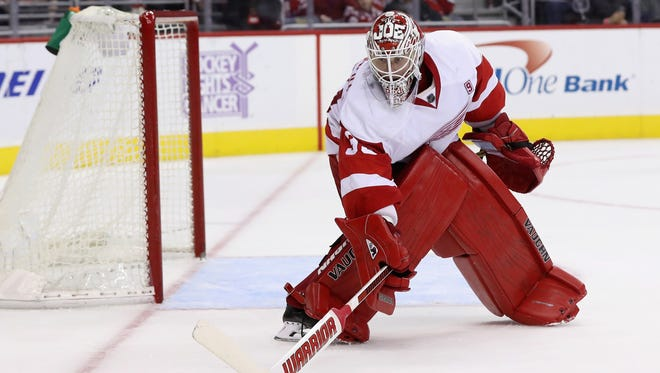Goalie Jimmy Howard of the Detroit Red Wings deflects a shot against the Washington Capitals on Nov. 18, 2016, in Washington, DC.