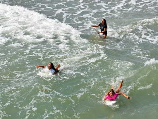 One of the 14-18 shortboard heats. Sunday at the Salty Sweet Women's Pro-Am Surf Contest hosted by the Cocoa Beach Pier. The competition included kids and adults in several categories.