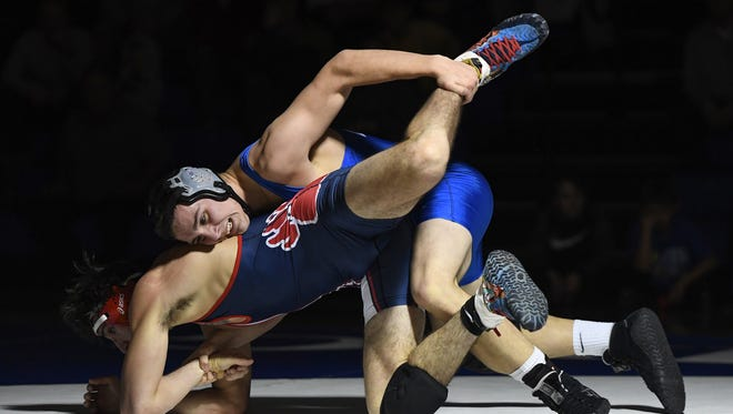 Eastside's Chase Barnes, top, wrestles BHP's Gage Lanier in the 182-pound weight class during the third round of the Class AAAA playoffs on Monday, February 5, 2018, at Eastside High School. Barnes defeated Lanier 10-0.