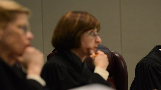Justice Jaynee LaVecchia, center, has written the latest Mount Laurel rulings for the state Supreme Court.