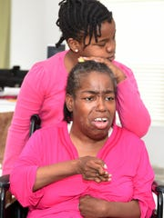 Lisa Hayes, a quadriplegic shown with her daughter