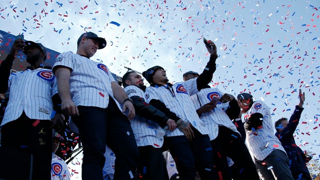 Chicago cubs players celebrate during a rally honoring the World Series champions at Grant Park in Chicago, Friday, Nov. 4, 2016.