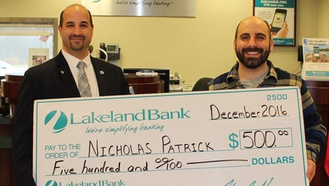 Caption: Jim Konzel, left, manager of the Hampton branch of Lakeland Bank, presents Debit Card Sweepstakes winner Nicholas Patrick with a $500 check.Caption: Jim Konzel, left, manager of the Hampton branch of Lakeland Bank, presents Debit Card Sweepstakes winner Nicholas Patrick with a $500 check.