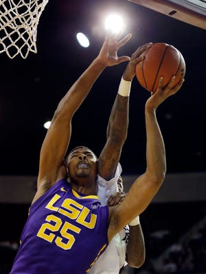 LSU forward Jordan Mickey (25) tries to shoot over the defense of a Mississippi State player in the second half of a NCAA college basketball game in Starkville, Miss., Saturday, Jan. 31, 2015. Mississippi State won 73-67. (AP Photo/Rogelio V. Solis)