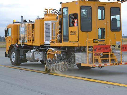 A line painter at Seattle-Tacoma International Airport.