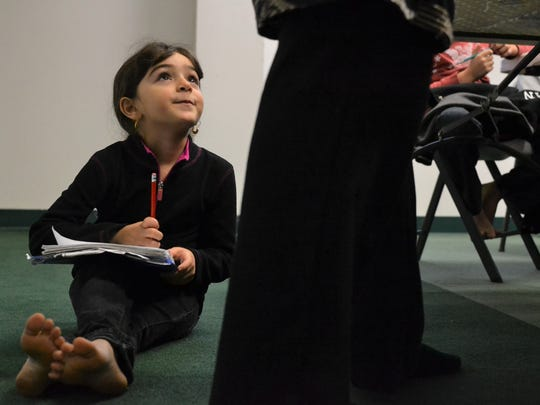 Arwa Adbulqader, 6, listens intently during a Sunday school program at the Islamic Society of Clemson on Sunday morning.