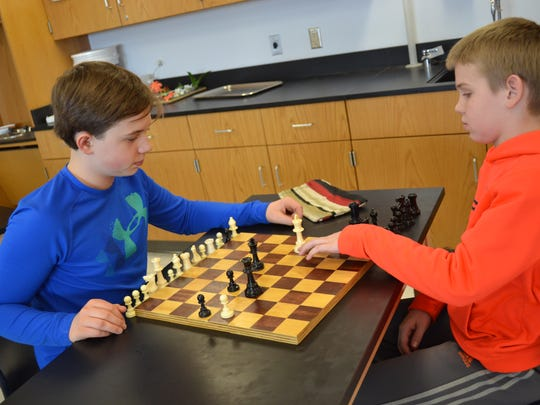 Woodmore Chess Club members Camden Knepper, left, competes against Cole Almroth during an in-club competition.