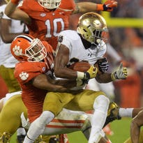 Clemson defensive end Kevin Dodd tackles Notre Dame's C.J. Prosise Saturday night.