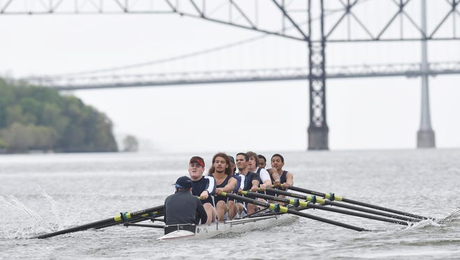 The Poughkeepsie boys varsity 8 boat wins the first flight during the Triangulars Regatta at Hudson River Rowing Association in Poughkeepsie on Saturday.