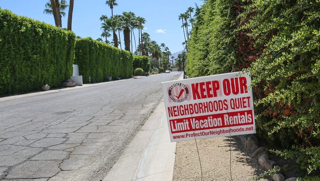 A sign in front of a home in the Deepwell neighborhood in Palm Springs advocates for limiting vacation rentals, August 29, 2016.