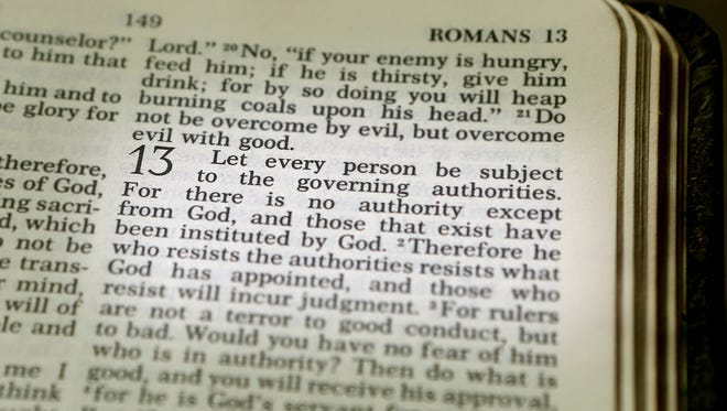 """November 8, 2016 - Paul writes in Romans 13 about how believers are to live in love and to get along peaceably with all people. Sometimes that's more difficult and it's not an easy issue. But the general principle is clear; God ordained government authority, therefore we must be in subjection to it or we are in direct rebellion against God Himself. We do not like being under authority or the idea of submission. There is an attitude of rebellion toward government, family and the church. All authority on earth comes from God. """"Let every person be subject to the governing authorities. For there is no authority except from God, and those that exist have been instituted by God. Therefore whoever resists the authorities resists what God has appointed, and those who resist will incur judgment,"""" Romans 13:1-2 (ESV). Our great nation just elected a president; now is the time to unite and work together knowing that all authority comes from God. """"1,000 Words"""" is a pictorial commentary on events in Greater Memphis and around the world. Today's """"1,000 Words"""" was written by Stan Carroll, a photographer for The Commercial Appeal."""