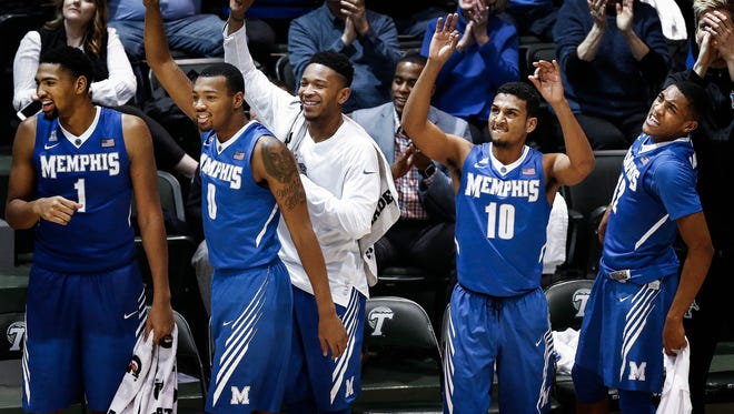 University of Memphis teammates (left to right) Dedric Lawson, K.J. Lawson, Markel Crawford, Christian Kessee, and Craig Randall II celebrate during the final minute of a 80-59 victory overTulane University at Fogelman Arena in Devlin Fieldhouse in New Orleans, La.