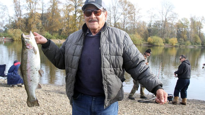Gustavo Rios of Salem holds his 7.5 pound rainbow trout at Walter Wirth Lake in 2012.