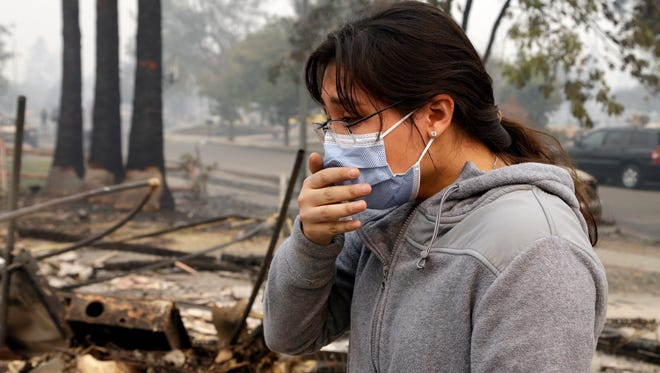 """Leslie Garnica cries while recalling the fire which destroyed her family home in the Coffey Park area of Santa Rosa. Garnica, a 17-year-old high school senior who was born and raised in Coffey Park, liked to open her blinds and window so she could see the three palm trees in her front yard as she laid in bed and listened to music. """"This is all I've ever known, and it's kind of weird knowing that you have to start again, find something new,"""" Garnica said. """"This is what I'm used to. But I don't have it anymore."""""""