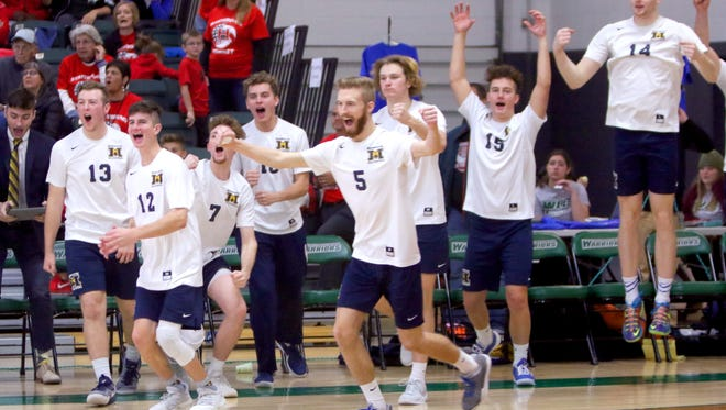 Marquette's bench clears on the final point in its three-set win over Racine Horlick in a WIAA boys state volleyball quarterfinal Friday at Wisconsin Lutheran College.