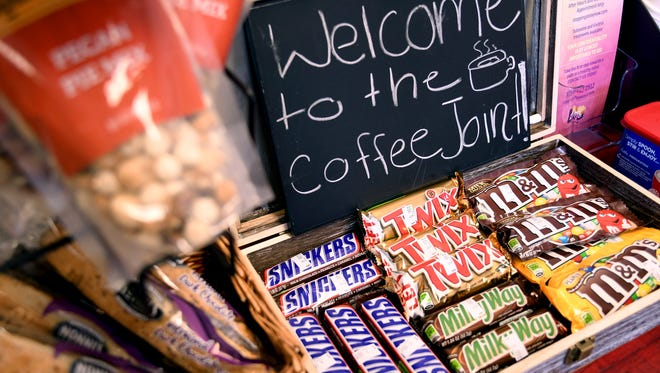 A welcome sign greets customers at the Coffee Joint in Denver, Friday, Feb. 9, 2018. The business' owners made an initial public pitch to the city Friday to be among the first legal marijuana clubs. The business only serves snacks and coffee currently, but its owners want to create a space where people can vape or use edible marijuana. (AP Photo/Thomas Peipert)