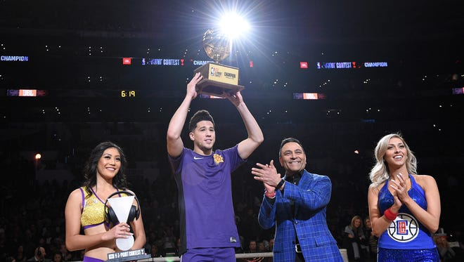 Devin Booker accepts the trophy for the 2018 JBL Three-Point Contest at Staples Center on February 17, 2018 in Los Angeles, California.  (Photo by Kevork Djansezian/Getty Images)