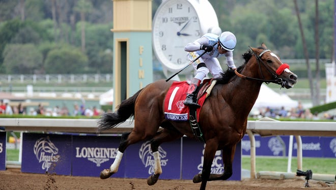 ARCADIA, CA - OCTOBER 31:  Goldencents crosses the finish line as Rafael Bejarano celebrates to win the 2014 Breeder's Cup Dirt Mile at Santa Anita Park on October 31, 2014 in Arcadia, California.  (Photo by Harry How/Getty Images)