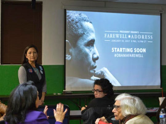 New Mexico Democratic chair Debra Haaland, standing, gathers to watch President Barack Obama's farewell address in Albuquerque, N.M., Tuesday, Jan. 10, 2017, As Obama said goodbye and thanked supporters on Tuesday night in his adopted hometown of Chicago, the occasion marked the unofficial countdown to the end of his historic presidency and Democrats gathered around the country to listen to his final words.