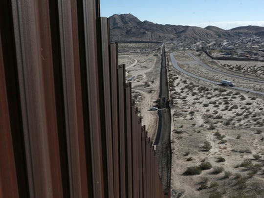 "FILE - In this Wednesday, Jan. 25, 2017 file photo, a truck drives near the Mexico-US border fence, on the Mexican side, separating the towns of Anapra, Mexico and Sunland Park, New Mexico.  U.S. Customs and Border Protection said Friday, Feb. 24, 2017 that it plans to start awarding contracts by mid-April for President Donald Trump's proposed border wall with Mexico, signaling that he is aggressively pursuing plans to erect ""a great wall"" along the 2,000-mile border."