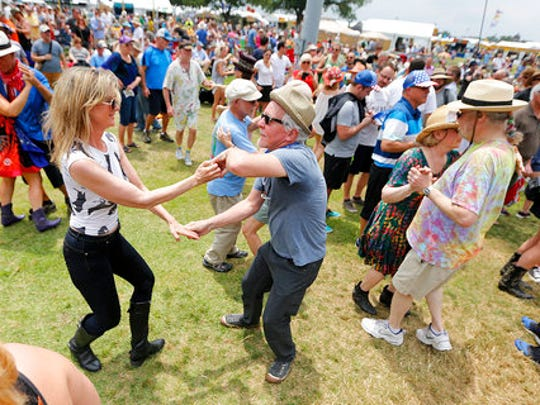 Jennie McColl and Bern Pagan, both from the D.C. area, dance during the New Orleans Jazz and Heritage Festival at the Fairgrounds, Friday, April 25, 2017.