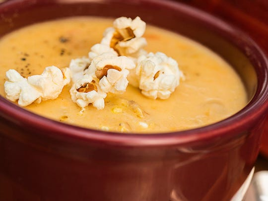 Cheddar popcorn is an optional garnish for beer cheese soup. Use a good Indy craft ale or lager beer.