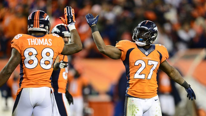 Denver Broncos running back Knowshon Moreno (27) and wide receiver Demaryius Thomas (88) react to Sunday's win against the San Diego Chargers.