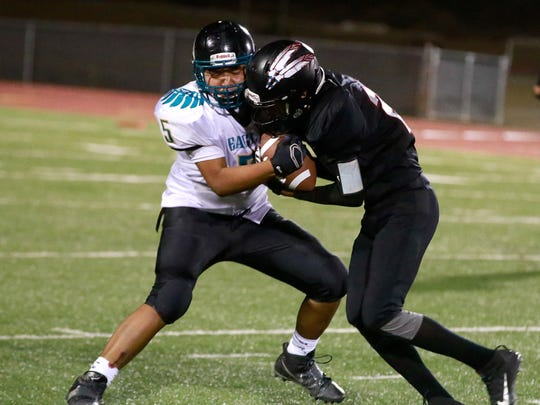 Navajo Prep's Ty Ashley, left, has the ball stripped by Shiprock's Adrian Gibson on Friday at Chieftain Stadium in Shiprock.