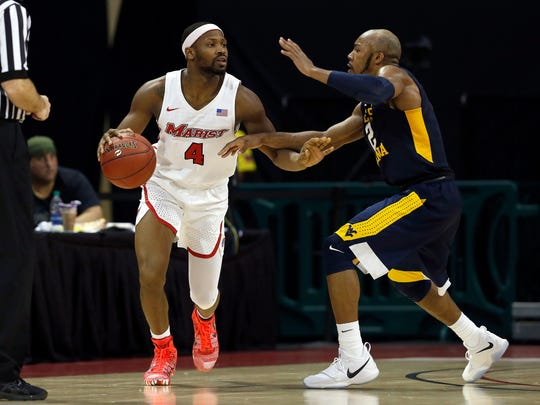 Nov 23, 2017; Kissimmee, FL, USA; Marist Red Foxes forward Isaiah Lamb (4) drives to the basket as West Virginia Mountaineers guard James Bolden (3) defends during the second half at HP Field House. Mandatory Credit: Kim Klement-USA TODAY Sports