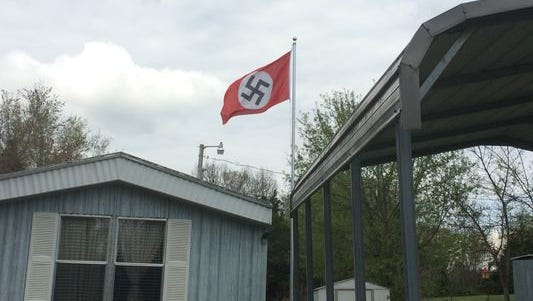 A Nazi flag flies over a home on Highway 76 near Springfield.