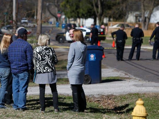 Neighbors talk as police investigate the scene of a shooting on Hampton Avenue just north of Seminole Street on Thursday, March 2, 2017.