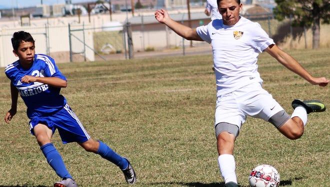 Alamogordo's Julian Torres takes a shot at the goal Saturday morning at the Riner Steinoff Soccerplex.