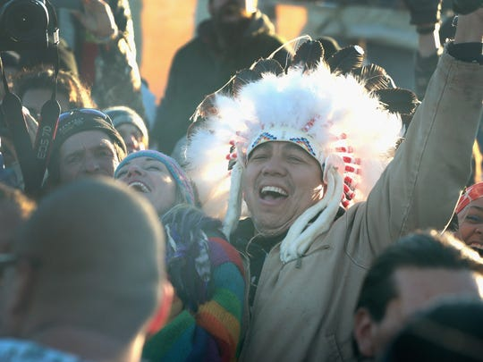 Native American and other activists celebrate after