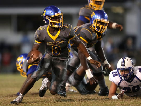 Rickards Marcus Riley scrambles out of the pocket against Godby during their game at Cox Stadium on Friday night.